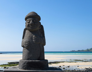 Dol hareubang statue on the beach at Jeju island symbol of Jeju do