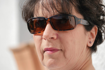 portrait of brunette mature woman with sunglasses