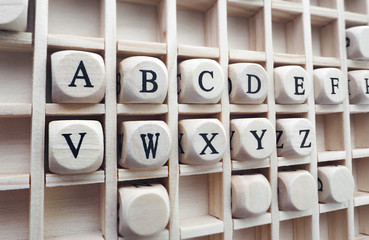 alphabet words made with building wooden blocks / Composition of the words alphabet with wooden cubes in square box