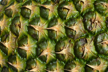 Pineapple fruit close-up. Texture of ananas pattern skin.