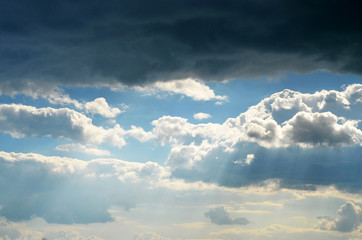 beautiful cloudy sky. the sun's rays pass through the clouds
