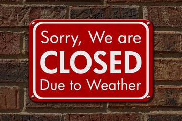 Closed due to weather sign