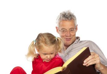 Grand-father read to his grand-child