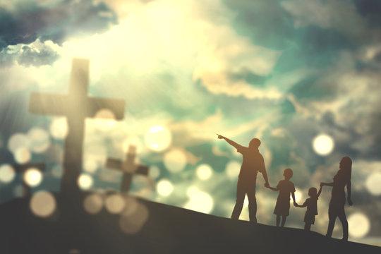 Family walk towards crucifix symbols