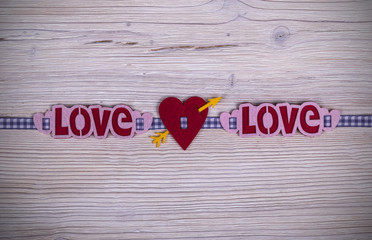 heart and word love on the white rustic wooden background with woodgrain texture
