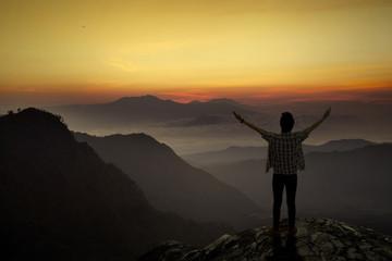 Man enjoy freedom at mountain
