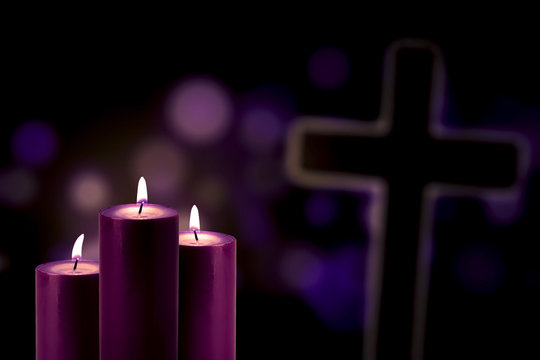 Purple candles with a cross symbol