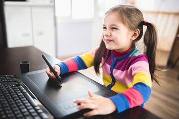 Little Girl Drawing On Graphic Tablet