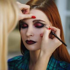 Process of applying makeup to the face, close-up