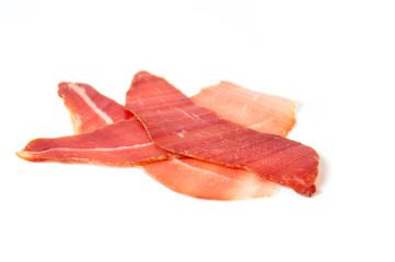 Prosciutto ham slice isolated on white