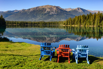 Three Adirondack Chairs