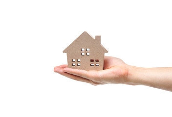 Hand holding a wooden house / Buying a house concept