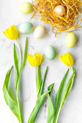 Easter concept eggs with tulip top view pattern
