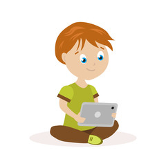 Boy sitting on the floor with a tablet in hands. The child reads or plays on an electronic device. Flat character isolated on white background. Vector, illustration EPS10.