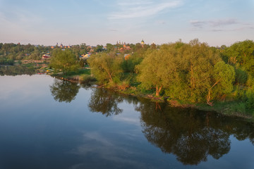 Spring evening landscape with the river and a small town on the shore.River Osetr and the city of Zaraysk in Moscow region