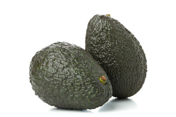 Two whole, uncut ripe avocado fruit