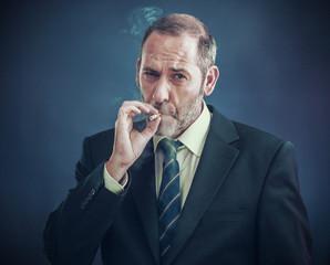 Mature Businessman smoking a cigarette