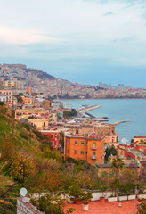 Old Italian town in Autumn. Coastal town with red stone buildings by the sea