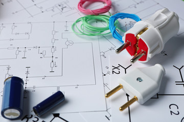 Different electrical tools on paper circuit drawing background