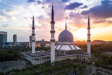Aerial - Sunrise at a Mosque. Sultan Salahuddin Abdul Aziz Shah Mosque is Malaysia's largest mosque and also the second largest mosque in Southeast Asia.