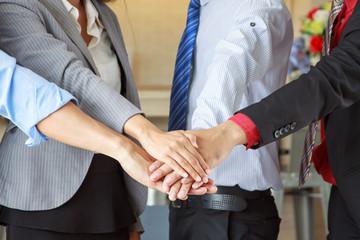 Business group united hands together, teamwork concepts