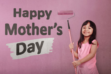 Happy asian little girl holding roller brush paint Happy Mothers day message