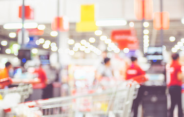 Blurred background of customer shopping at supermarket store blur background with bokeh