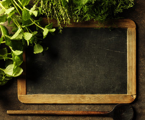 Wall Mural - Blank chalkboard with herbs.