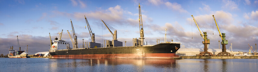 high-resolution panorama seaport ,unloading of merchant ships Fototapete