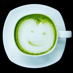 green tea latte on back background