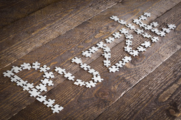 word puzzle with the puzzle on a wooden background