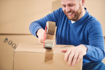 man moving in new apartment with many boxes with stuff