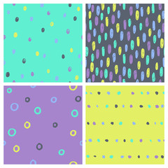 Set of bright paint drops seamless patterns. Vector hand drawn background