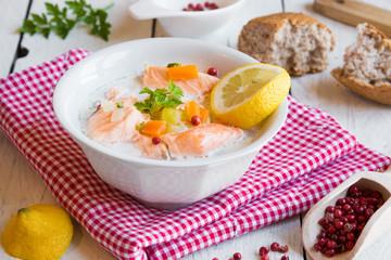 Salmon fish soup with cream and lemon