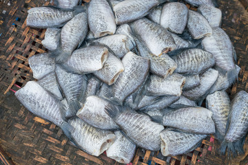 Thai traditional preserved fishes : Top view of dried salted damsel fish in the market.