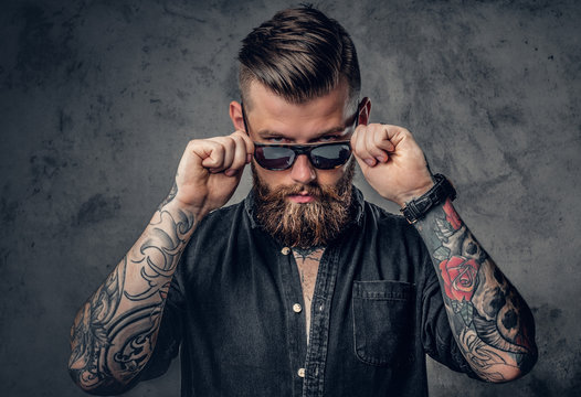 A man with tatoos on his arms.
