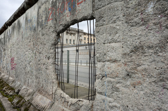 Germany, Berlin, documentation center Topography of Terror: Detail of the old Berlin wall with buildings in the background.