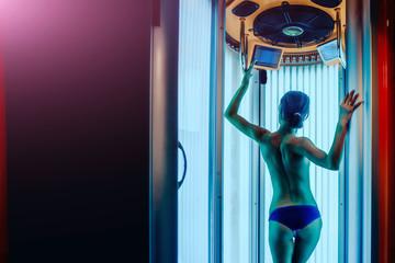 pretty woman with sexy body in solarium