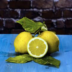 Lemons on a blue wood / Acid and yellow fruit. Lemons on a blue wood, stock photo