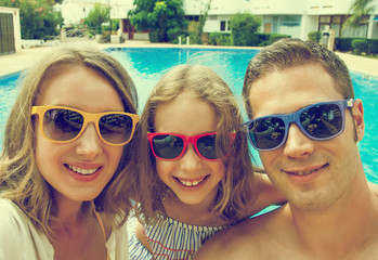 Happy family taking selfie on vacations.