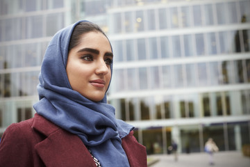 British Muslim Businesswoman Standing Outside Office