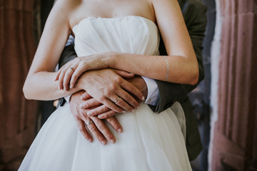 bride and groom hands