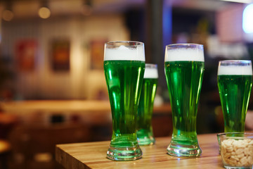 Group of glasses with Irish beer on wooden table