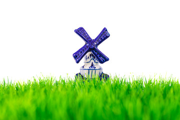 Dutch porcelain windmill in front of green grass
