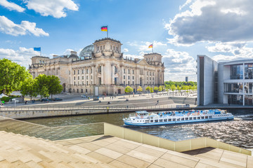 Poster Berlin Berlin government district with Reichstag and ship on Spree river in summer, Berlin Mitte, Germany