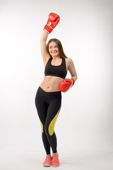 Young fitness woman with boxing gloves