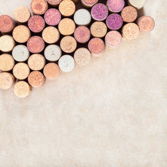 Wine corks background. Used wine corks arranged diagonally on blurred light background. Copy sparse for your text.