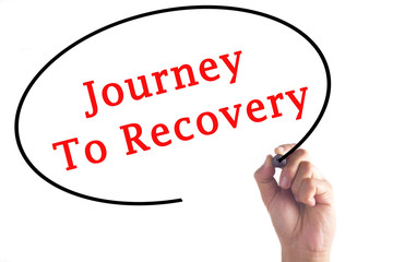 Hand writing Journey To Recovery on transparent board