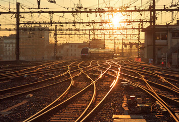 A train on the railroad tracks at Perrache station in Lyon (Gare de Lyon-Perrache), France, during sunrise.