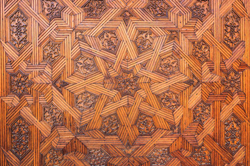 Background of arabic decoration on carved wood.